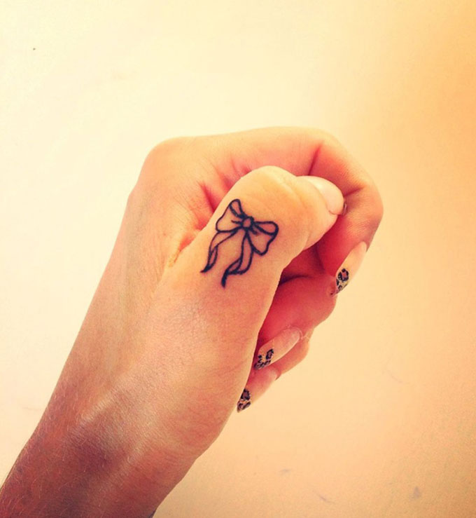 Bow Finger Tattoo