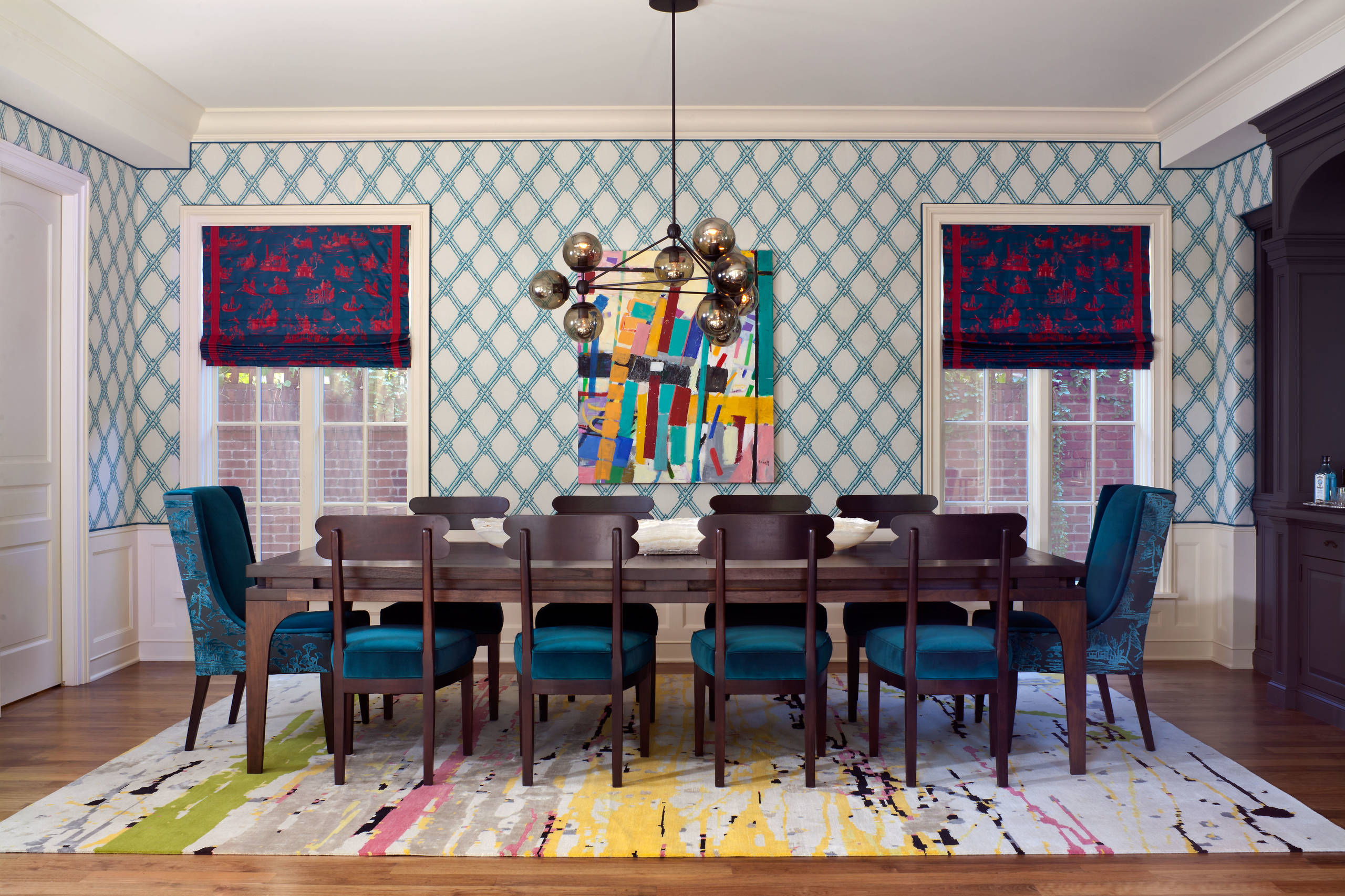 Design ideas for an eclectic enclosed dining room in Denver with multicolored walls and dark hardwood floors