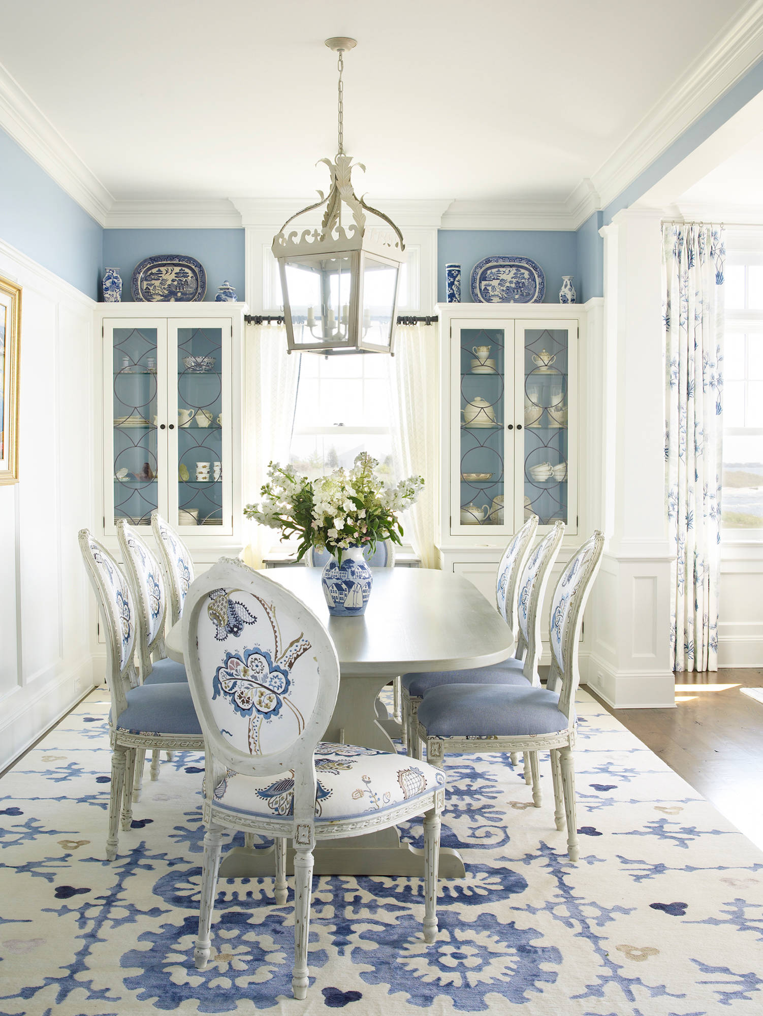 beach style dining room with color of white and blue decoration